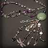 Beaded Necklace by Kris Glenn, Dirt Road Jewelry LLC, Santa Fe New Mexico. Custom Bracelets, Necklaces and Earrings. Jade pendant, sterling silver Balinese beads, faceted fluorite, pearls, cloisonné and a variety of sterling silver charms.